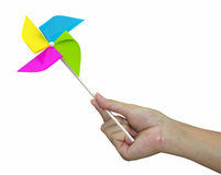 Hand with pinwheel. Hand with  pinwheel on white background Stock Photography