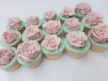 Hand piped buttercream vintage rose cupcakes Stock Photos