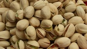 Hand and pistachios stock video