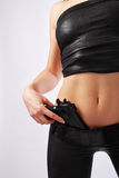 Hand with pistol and sexy body in leather. Stock Photography