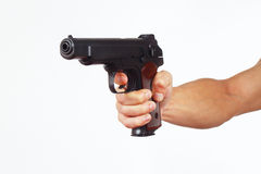Hand with pistol on white background Stock Photography