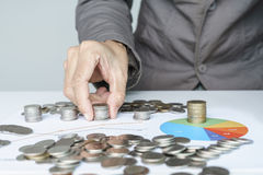 Hand place the money coins in paper chart royalty free stock photography