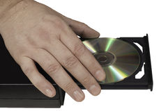 Hand placing a CD in a drive tray (2/3) Royalty Free Stock Images
