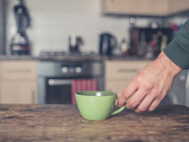 Hand placing cup on table Royalty Free Stock Photo