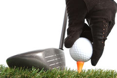 Hand placing golf ball to a tee Royalty Free Stock Images