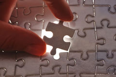 Hand placing missing puzzle piece Royalty Free Stock Photo
