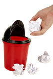 Hand placing paper in trash Royalty Free Stock Image