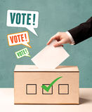 A hand placing a voting Stock Images