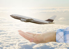 Hand with plane Royalty Free Stock Image