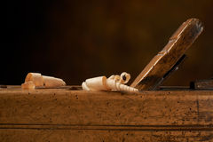 Hand plane on a wooden workbench. Royalty Free Stock Photos
