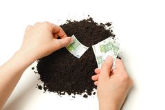 Hand planting Euro banknotes. Hand planting 100 Euro banknotes in a pile of dirt Stock Photos