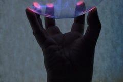 Hand and plasma Stock Photos