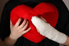 Hand in plaster. And red heart Royalty Free Stock Images