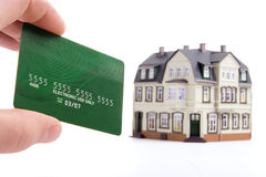 Hand and plastic card payment for the house Stock Photography