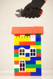 Hand plastic toy house color red roof Stock Photo