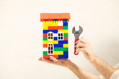 Hand plastic toy house color red roof Royalty Free Stock Image
