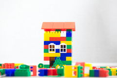 Hand plastic toy house color red roof Royalty Free Stock Photography
