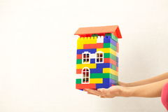 Hand plastic toy house color red roof Stock Photography