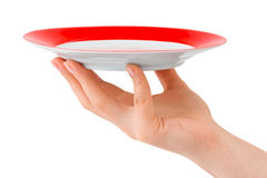 Hand with plate Royalty Free Stock Image