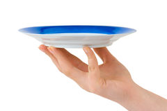 Hand with plate Royalty Free Stock Photography