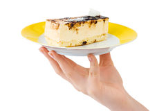 Hand and plate with cake Stock Photo