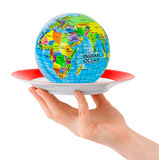 Hand with plate and globe Royalty Free Stock Photo