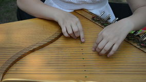 Hand play baltic psaltery Stock Images