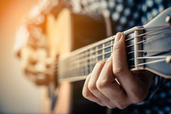 Hand play guitar. Royalty Free Stock Image