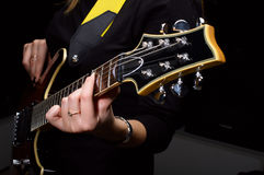 Hand play on guitar strings. Hand play on electrical guitar strings in music study Royalty Free Stock Photography