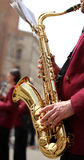 hand of player and the golden saxophone royalty free stock image