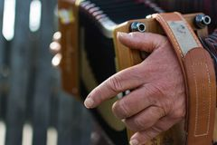 Hand playing accordian Royalty Free Stock Photo