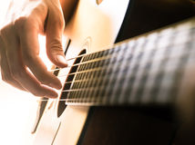Hand playing acoustic guitar. Royalty Free Stock Photos