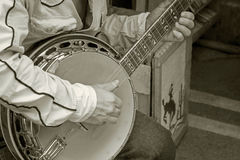Hand playing banjo guitar monotone color Stock Images