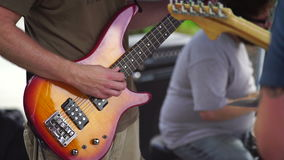 Hand playing the bass guitar. 4k stock video