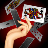Hand with a playing card. Hand of woman holding playing card of Queen of Spades on dark red background. Casino game concept design. There is in addition a vector vector illustration