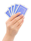 Hand with playing cards. Isolated on white background stock images