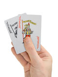 Hand with playing cards Stock Images