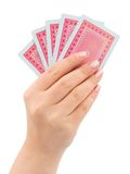 Hand and playing cards. Isolated on white background royalty free stock images