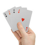 Hand with playing cards (Aces) Stock Photo