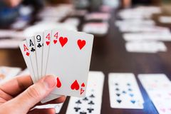 Hand of playing cards in card game royalty free stock image