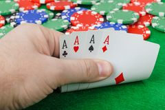 Hand with playing cards in casino stock images