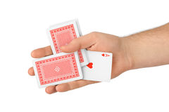 Hand and playing cards Stock Images