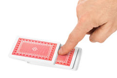 Hand and playing cards Royalty Free Stock Photo