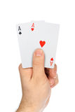 Hand with playing cards Stock Photos