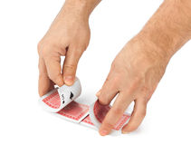 Hand and playing cards Stock Photo