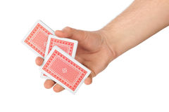 Hand and playing cards Royalty Free Stock Photos