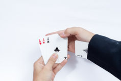 Hand with playing cards isolated on white background Stock Photos