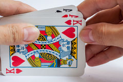 Hand with playing cards isolated on white background Royalty Free Stock Photography