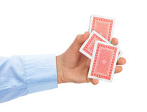 Hand and playing cards Stock Photos