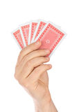 Hand with playing cards. Isolated on white background royalty free stock image